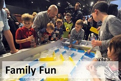 Families taking part in interactive exhibits at the DaVinci Discovery Center