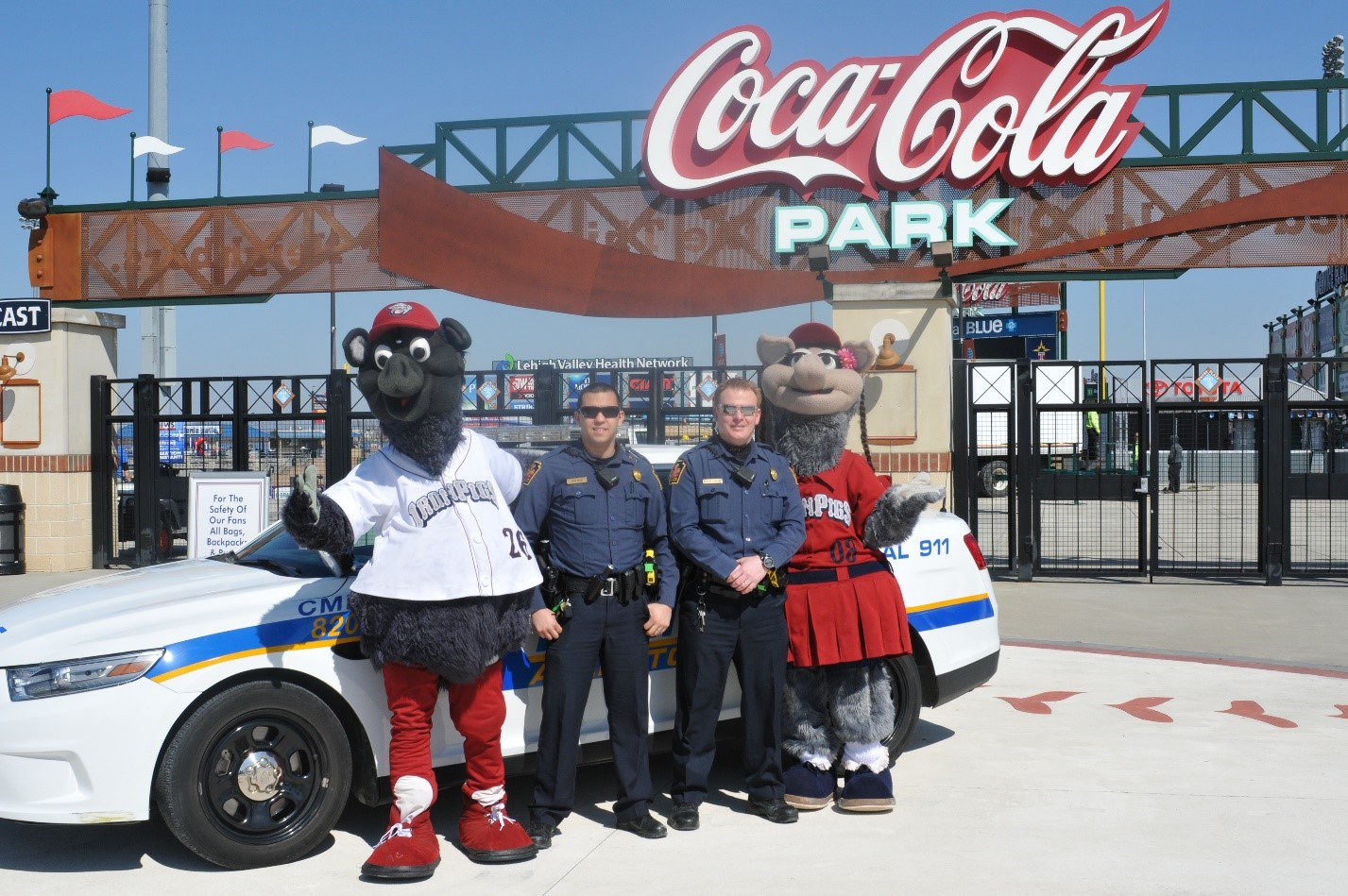 Ferous, Officer Perez, Officer Bowland, and FeFe outside CocaCola Park